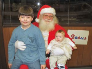 Baby Garrett with his older brother Adam sitting on Santa's lap